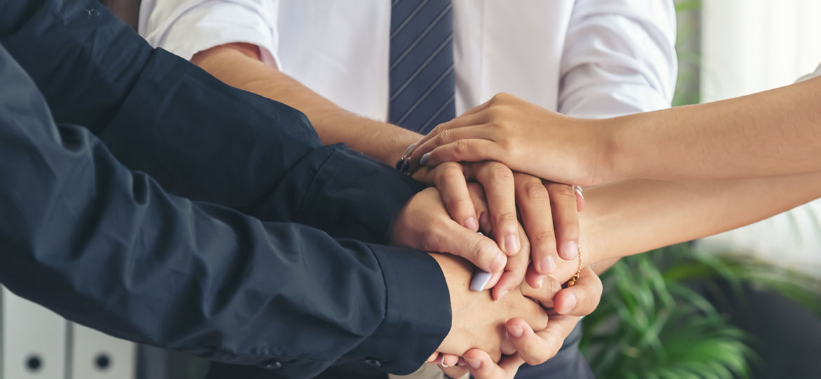 Hand stack and hold together in team for success something or ta